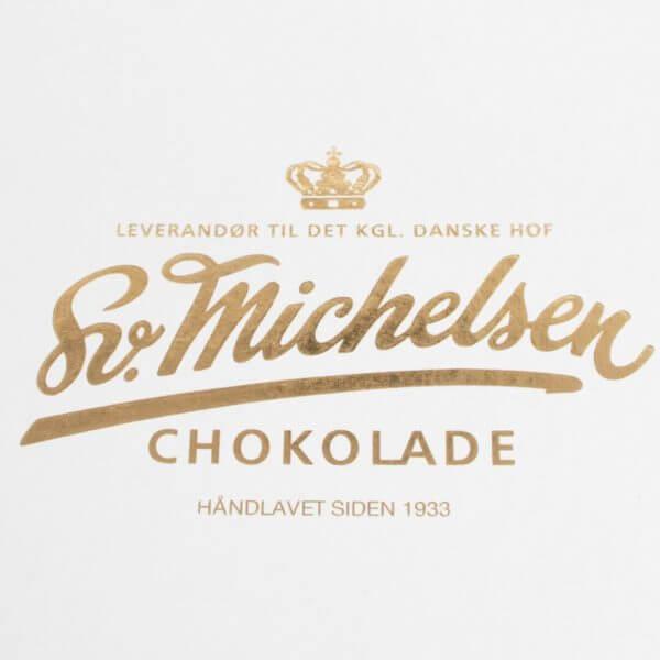 billede af låget af chokoladeæske, som viser Sv. Michelsens bomærke